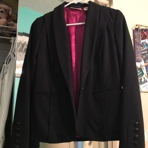 Black suit jacket by DKNY.